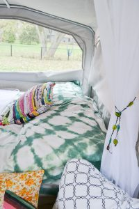 I love the classic look of indigo shibori, but this dark green color is so pretty too. Pop up camper remodel with an eclectic vintage boho feel via Refresh Living.