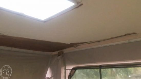 Glue up ceiling panels are an easy way to update a ceiling in a camper (or home). These panels covered up some water damage after the roof was repaired.