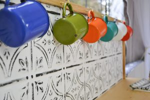 A great idea for a DIY back splash - painted ceiling tiles!