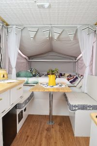 I want to camp in this! A 1990s pop-up camper gets a complete remodel, including a new roof to replace the leaky one.