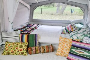 I want to camp in this! A 1990s pop-up camper gets a complete remodel, including a new roof to replace the leaky one. Pop up camper remodel with an eclectic vintage boho feel via Refresh Living.