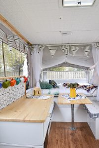 This camper is full of DIY projects - you'd never believe how it looked before. Pop up camper remodel with an eclectic vintage boho feel via Refresh Living.