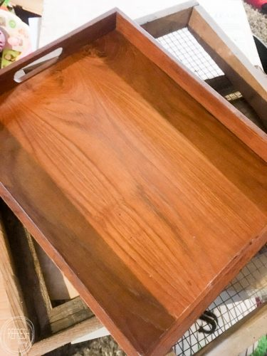 An old wooden tray from the thrift store is upcycled into a beautiful DIY gift for a new homeowner.