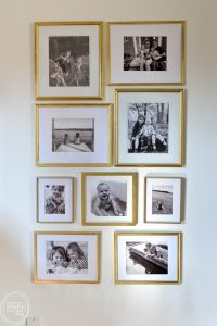 I can't believe this gold gallery wall is made from second hand frames and cost less than $20! Black and white photos in gold frame gallery wall via Refresh Living