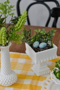 I love milk glass and this greenery looks perfect in it. This spring decor has a vintage farmhouse feel. Spring home tour with upcycled and vintage finds.