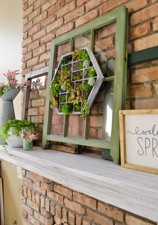 Just paint a wooden trinket case or toy box and then add in faux succulents. Easy succulent planter ideas to hang on the wall via Refresh Living.