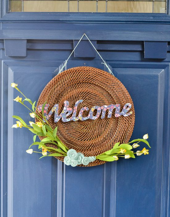This is a great idea on how to make a inexpensive DIY spring wreath using a thrift store find. For less than $5, you can make a custom spring front door decoration!