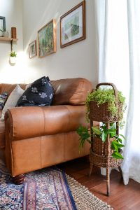 This living room is full of second hand finds. I love the vintage modern feel with eclectic finds and greenery and plants.
