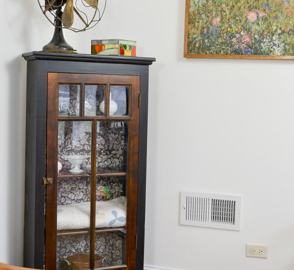 I love how this piece was refinished with black paint contrasting with the wood and the modern black and white floral background.