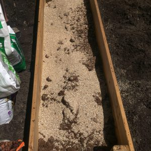 Don't waste money and buy the premixed raised garden bed soil blend, instead, make your own for a lot less! This easy soil mixture combines only three parts and is easy to make, plus it will create proper drainage for your vegetables.
