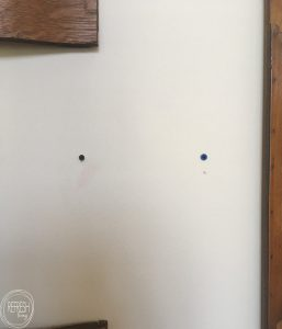 This trick for hanging objects with two brackets on the wall really works. A great way to hang picture frames and other objects level without making a ton of holes in the wall.