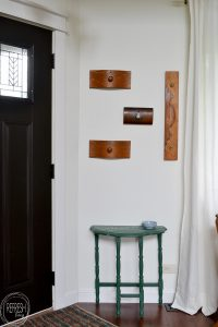 This is the size of my entryway too - a small wall right by the door. Love the idea of using drawer fronts to make a decorative coat rack right by the door!