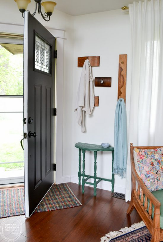 Love this idea for a coat rack for a small entryway! It's decorative and functional, and even better, it reuses old items (dresser drawer fronts) that would otherwise be thrown away.