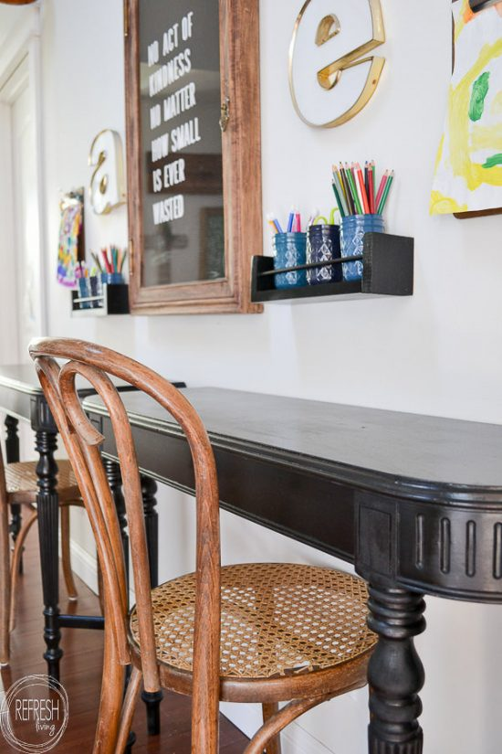 What a great idea to use an old table to make kids desks! Just cut off each end and attach it to the wall for wall desks that don't take up much space, and are inexpensive.