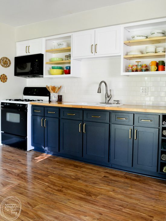 Love the dark blue with the butcher block countertops and the white upper cabinets. This kitchen was refaced (cabinet doors replaced), but the existing cabinet bases remained.