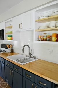 What an easy way to make open shelves in your kitchen! Just remove the doors, cut out the stile, paint the inside of the cabinet, and add thicker shelves.