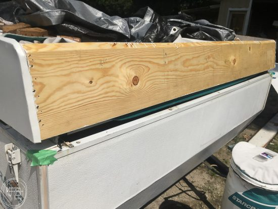 How we repaired our water damaged pop up camper roof by rebuilding parts of the frame and reusing other parts.