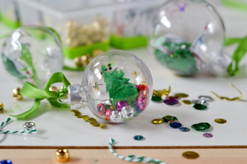 This is a great way for kids to make their own ornaments using clear ornaments. The perfect craft for Christmas classroom parties for young kids.
