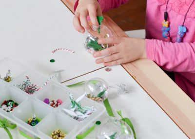 Gather odds and ends and left young kids fill up clear ornaments with them. A great craft for holiday classroom parties!