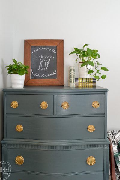Use a paint sample from the any home improvement store to make your own DIY chalk paint to easily paint furniture in any color! Modern dark green dresser painted with DIY chalk paint.