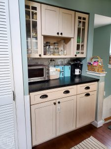 This boring kitchen with off white cabinets is going to be updated into a modern kitchen with vintage touches.