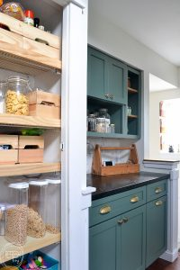 This budget friendly kitchen makeover is perfect with green cabinets, soapstone counters, and a marble backsplash. A perfect mix of modern and vintage touches creates a beautiful space.