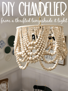 This DIY wood bead light fixture costs hundreds less than the store bought version via Refresh Living