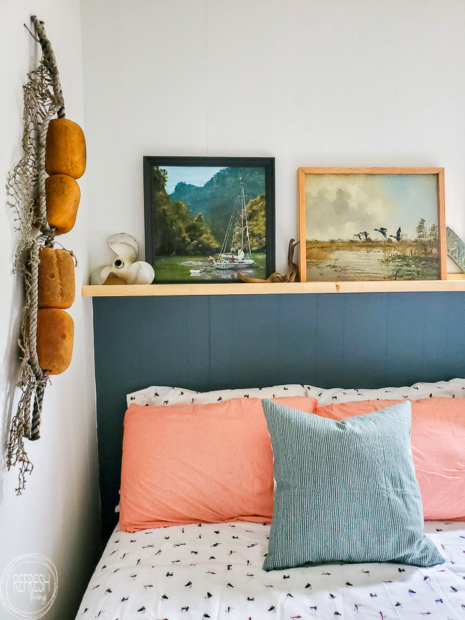What a great way to create the look of a headboard without spending a lot of money or time. The wood shelf can be decorated in so many different ways.