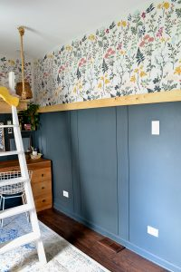 Bedroom makeover full of DIY and budget friendly projects. DIY loft bed, modern wainscot, refinished vintage furniture, and floral stencil to give the look of wallpaper.