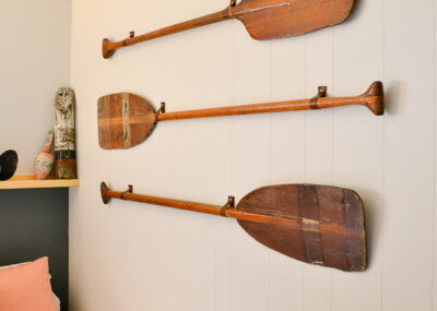 Such an easy but also pretty way to hang vintage oars or paddles on the wall. This would be great for a lake house or beach house!