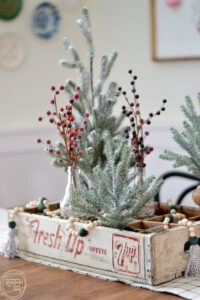 Use a vintage soda crate to create a unique Christmas centerpiece.