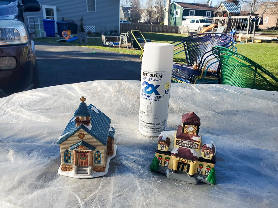 Paint ceramic houses from the thrift store to create a modern farmhouse look for a Christmas village.