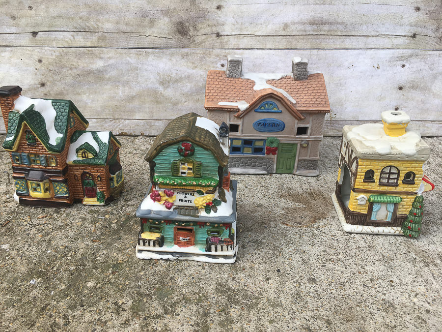 Easy way to update mismatched ceramic houses from the thrift store to create a farmhouse Christmas village.