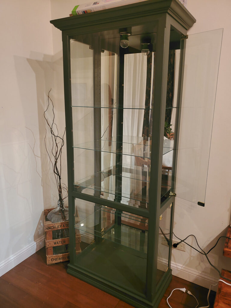 Display curio cabinet used to make an indoor greenhouse
